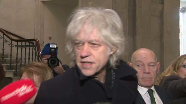 Various shots of Bob Geldof speaking to reporters after returning his Freedom of the City of Dublin award in protest against Aung San Suu Kyi who...