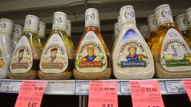 various shots of bottles of newman's own salad dressing on supermarket shelves in princeton illinois on february 5 dressing types include ranch... - salad dressing stock videos & royalty-free footage