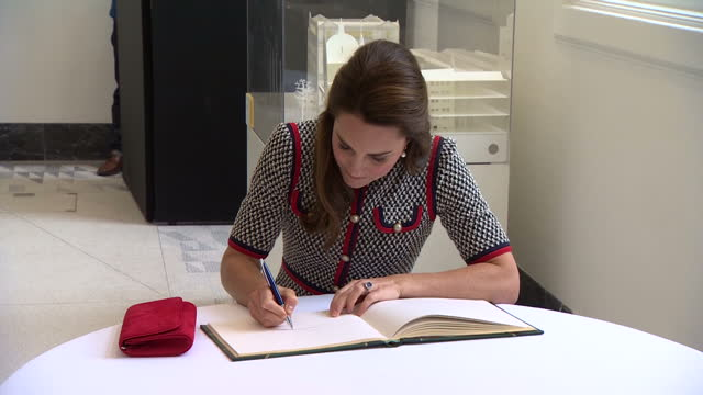 various shots of catherine duchess of cambridge signing the visitors' book and unveiling a plaque in the sackler courtyard to commemorate the... - victoria and albert museum london stock videos & royalty-free footage