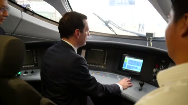 Various shots of Chancellor George Osborne boarding a bullet train at Chengdu East Railway Station and looking at the train controls in the driver's...