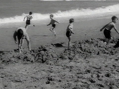 various shots of children digging holes on a beach - outdoor chair stock videos & royalty-free footage