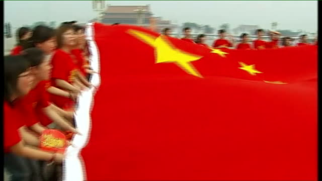 ext various shots of chinese mcdonald's workers as pose with chinese flag and chant mcdonald's slogan sot male chinese mcdonald's worker making 'v'... - mcdonald's stock videos and b-roll footage