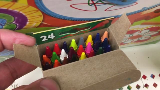 various shots of crayola crayons crayola will discontinue a color from the 24 count box - pastello video stock e b–roll
