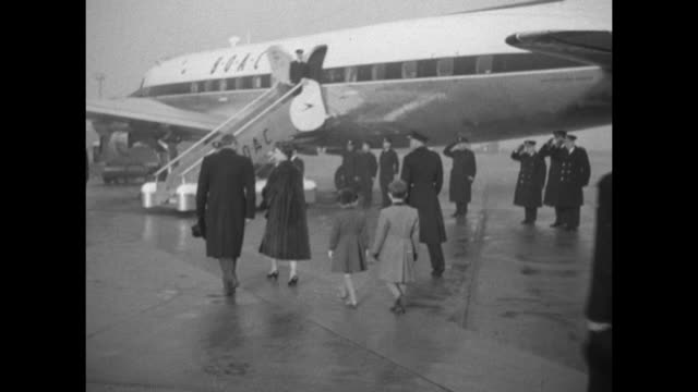 various shots of crowds at railing of heathrow airport observation deck / cu tail of british overseas airways corporation plane / queen elizabeth ii... - princess margaret 1950 stock videos and b-roll footage