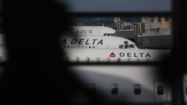 Various shots of Delta Air Lines planes at Ronald Reagan National Airport in Washington DC Wide shots of a row of Delta airplanes in the background...