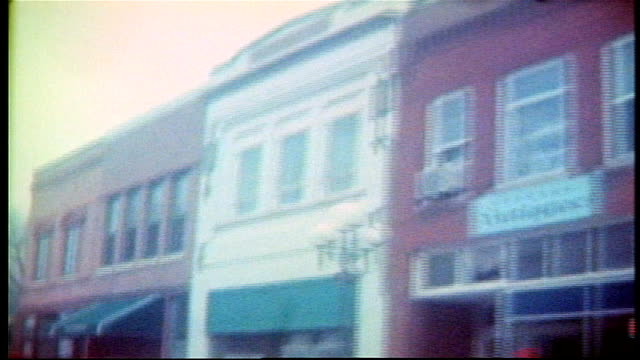 various shots of driving through small rural town in clear lake, wisconsin - targa con nome della via video stock e b–roll