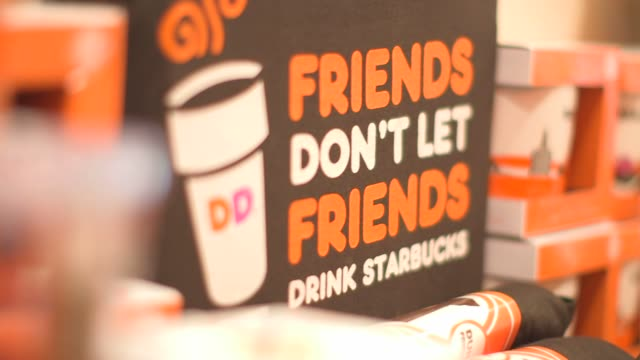 various shots of dunkin donuts merchandise on display in canton, ma on september 20 a medium shot of various dunkin donuts merchandise on display at... - coffee drink stock videos & royalty-free footage