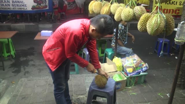 Various shots of durians sold on the roadside at a local market in Jakarta Indonesia on January 25 2017 Durian is a tropical fruit distinguished by...