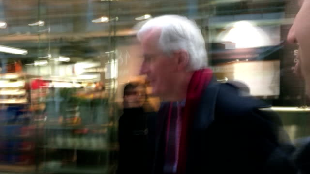 Various shots of European Commission Chief Negotiator Michel Barnier arriving at St Pancras Station in London and speaking briefly to a reporter...
