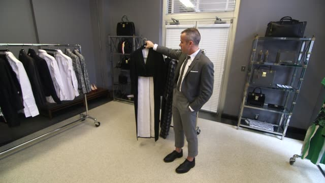 various shots of fashion designer thom browne at his retail location in new york city new york wide shots of designer thom browne showing off pieces... - black dress stock videos & royalty-free footage