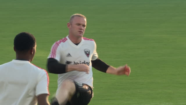 various shots of former england striker wayne rooney warming up ahead of his dc united debut at audi field wide shots of players warming up at audi... - major league soccer stock videos and b-roll footage