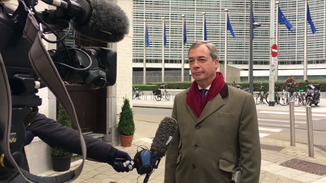 Various shots of former UKIP leader Nigel Farage MEP speaking to members of the media outside and inside a pub near the European Commission after a...