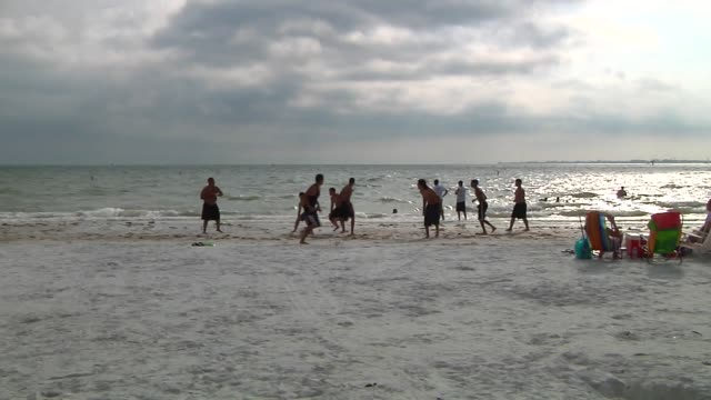 various shots of fort meyers beach on march 23 a wide panning shot of fort meyers beach with people relaxing on the beach a wide shot of kids playing... - fort myers beach stock videos & royalty-free footage