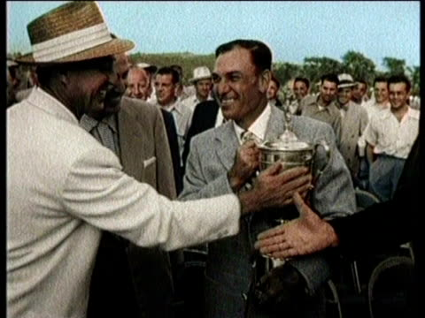 various shots of golfer, ben hogan playing in a golf tournament / ben hogan wins the tournament and accepts a trophy / narrated - narrating stock videos & royalty-free footage