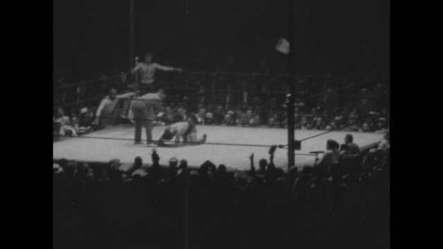 various shots of heavyweight boxers jack dempsey and jack sharkey entering boxing ring and standing in corners with cornermen at yankee stadium as... - boxing ring stock videos & royalty-free footage