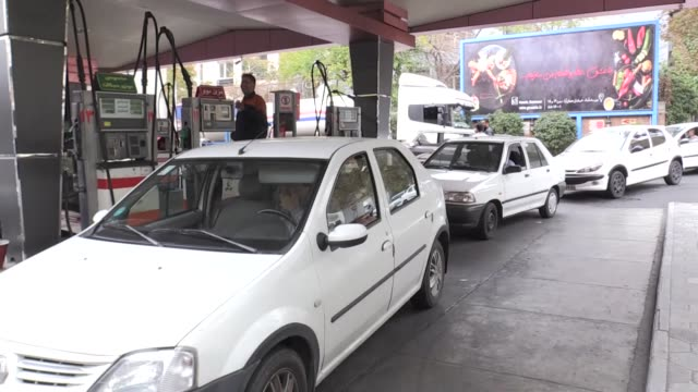 various shots of iranian drivers refuel their vehicles at a gas station in tehran iran on november 07 2018 us president donald trump's administration... - イラン点の映像素材/bロール