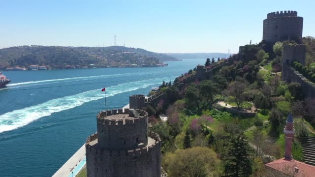 vídeos y material grabado en eventos de stock de various shots of istanbul's historical rumeli fortress, the dolmabahce clock tower and public parks with fully-bloomed judas trees on april 26, 2020.... - judas
