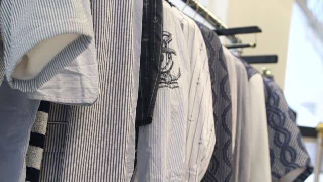 various shots of items in the thom browne collection in his retail location in new york city new york a medium tilt down shot of various thom browne... - hold me tight stock videos & royalty-free footage