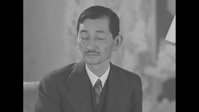 various shots of japanese ambassador to the us hiroshi saito reading news reports of japan's bombing of the uss panay / medium close up of saito... - 煙草製品点の映像素材/bロール
