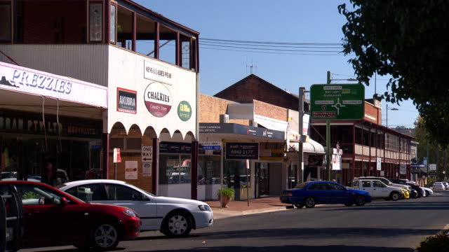 various shots of john street coonabarabran from point of view of the road centre - pan from royal hotel to regional australia bank / wide shot of... - directional sign stock videos & royalty-free footage