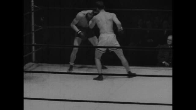 various shots of knockouts in golden gloves boxing matches / professional boxer max baer strutting about in suit and tie / close up baer / various... - arm wrestling stock videos & royalty-free footage