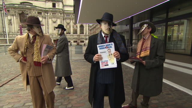Various shots of 'LeaveEU' campaigners wearing David Cameron masks and holding leaflets whilst posing for photographs