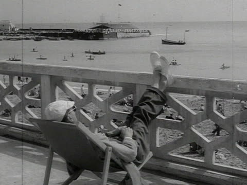 various shots of men asleep on deck chairs - outdoor chair stock videos & royalty-free footage