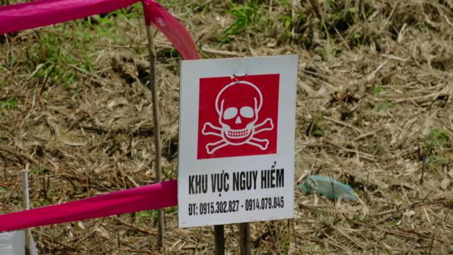 various shots of minefield being cleared, vietnam - 宝探し点の映像素材/bロール