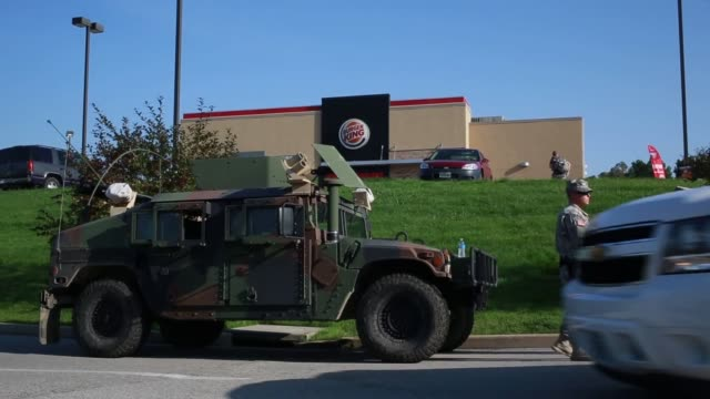 various shots of missouri national guard deployed at the police command center and standing on watch as protesters continue to rally and march in... - armored vehicle stock videos & royalty-free footage