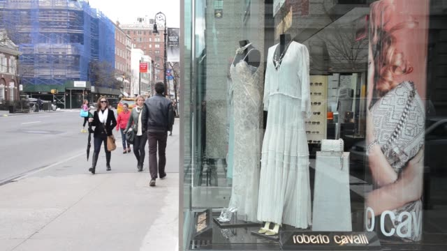 various shots of new york city retail stores on april 8 a medium shot of a michael kors window display showing womens clothing, a wide shot of a... - roberto cavalli designer label stock videos & royalty-free footage