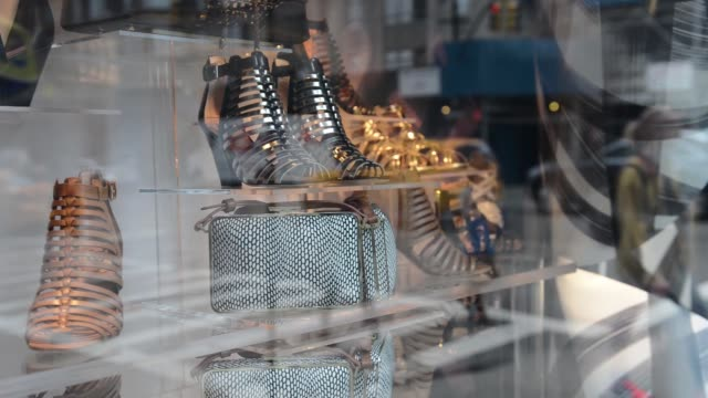 various shots of new york city retail stores on april 8 a medium shot of a roberto cavalli storefront window with pedestrians passing by, a tight... - roberto cavalli designer label stock videos & royalty-free footage