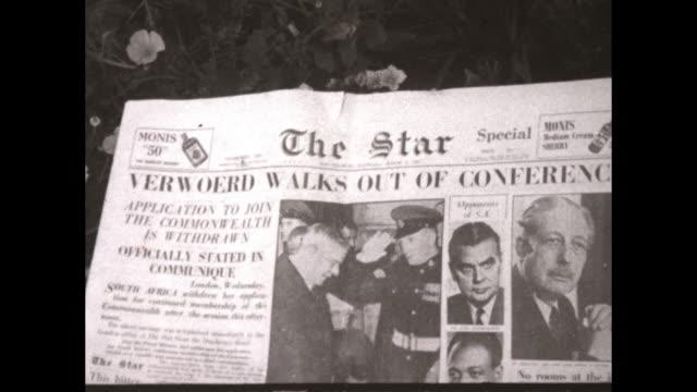 Various shots of newspaper headlines about South Africa Prime Minister Hendrik Verwoerd