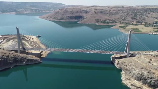 various shots of nissibi bridge spanning the ataturk dam lake on the euphrates river in southeastern sanliurfa province of turkey on july 09, 2018. - cable stayed bridge stock videos & royalty-free footage