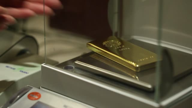 Various shots of one kilogram gold bars being inspected and weighed at a Tanaka Kikinzoku Kogyo K K store in Tokyo Japan on Tuesday March 25 A close...