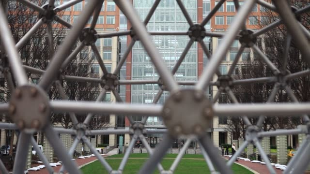 various shots of outside of the united states patent and trademark office in alexandria virginia on april 4 a wide shot of the corporate art in the... - intellectual property stock videos and b-roll footage