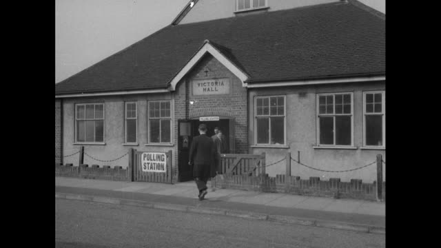 stockvideo's en b-roll-footage met various shots of people arriving at polling stations, that include locations of church's, halls and schools in the 1955 general election - 1955