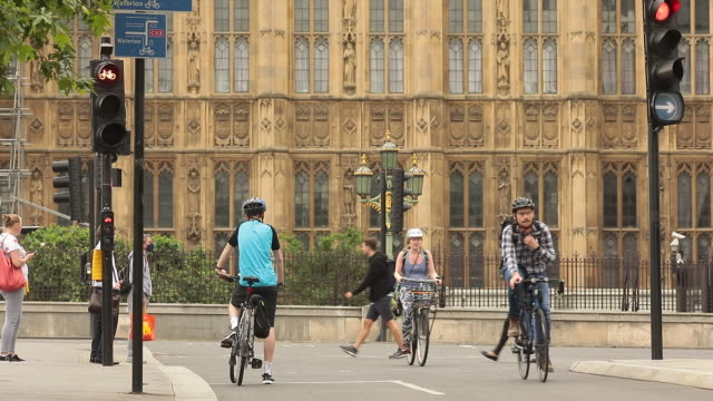 various shots of people cycling in central london during covid19 pandemic in london uk on monday june 22 2020 - sports helmet stock videos & royalty-free footage