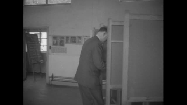various shots of people inside polling stations voting in the 1955 general election - ballot box stock videos & royalty-free footage