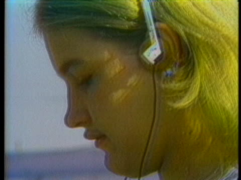 various shots of people listening to music on portable audio cassette devices and headphones. - cassetta video stock e b–roll