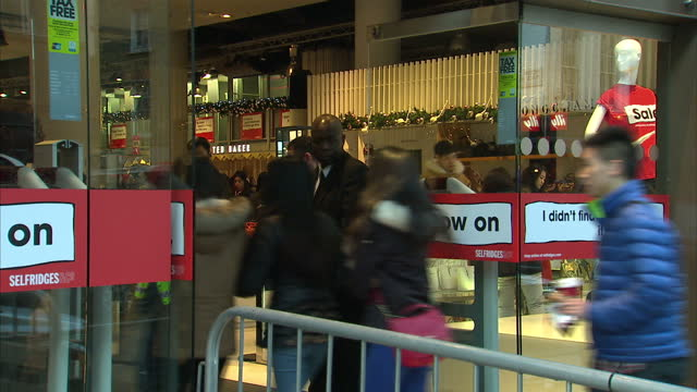 various shots of people queueing outside selfridges and browsing inside during the boxing day sales shoppers flock to boxing day sales on december 26... - markenname stock-videos und b-roll-filmmaterial