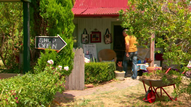 various shots of people rummaging through old and new wares exterior the old cows shop carcoar / ext store and shop open sign - rustic stock videos & royalty-free footage