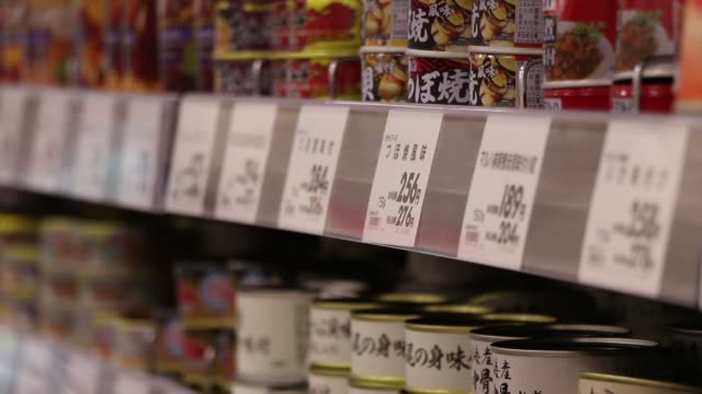 various shots of prcing signs on shelves of and aeon co supermarket in chiba japan on march 31 a close up of marlboro cigarettes and their price... - 価格点の映像素材/bロール