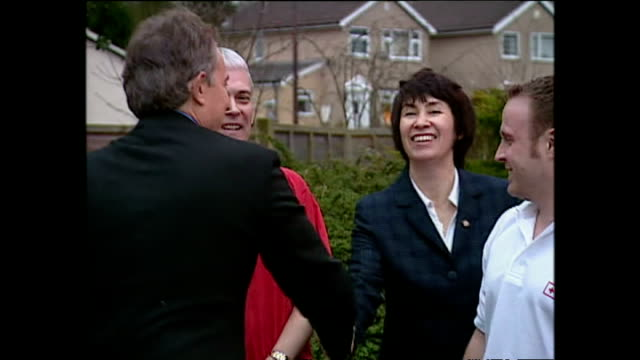 various shots of prime minister tony blair arriving at a branch of the british red cross meeting volunteers and watching money from the dec tsunami... - tony blair stock videos and b-roll footage