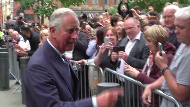 Various shots of Prince Charles and Camilla Duchess of Cornwall departing after attending a reception at Manchester Town Hall pausing briefly to...