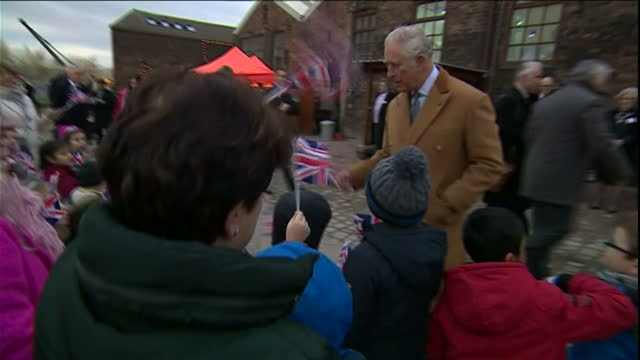 various shots of prince charles greeting flagwaving children during a tour of middleport pottery before unveiling a commemorative plaque and donning... - start flag stock videos & royalty-free footage