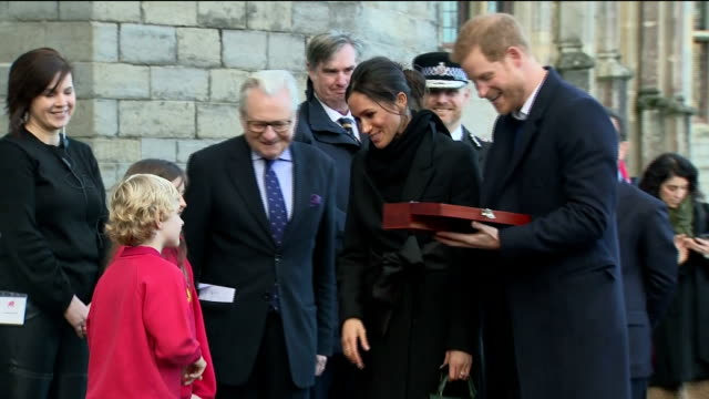 Various shots of Prince Harry and his fiancee Meghan Markle visiting Cardiff Castle and meeting with a group of young poets and musicians at an event...