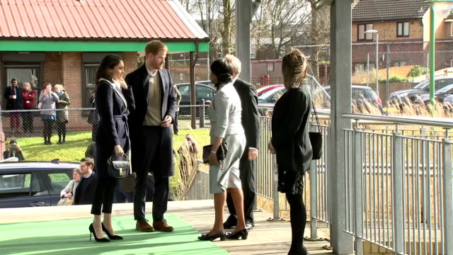 Various shots of Prince Harry and Meghan Markle arriving at Nechells Wellbeing Centre to join Birmingham's Coach Core apprentices as they take part...