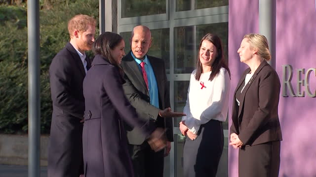 Various shots of Prince Harry and Meghan Markle arriving to visit Nottingham Academy and taking their seats in the school's assembly hall to watch...
