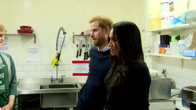 Various shots of Prince Harry and Meghan Markle visiting Social Bites a social enterprise cafe that distributes food to homeless people and employs...