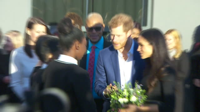 Various shots of Prince Harry and Meghan Markle walking out of the assembly hall and speaking to students and staff outside Nottingham Academy before...
